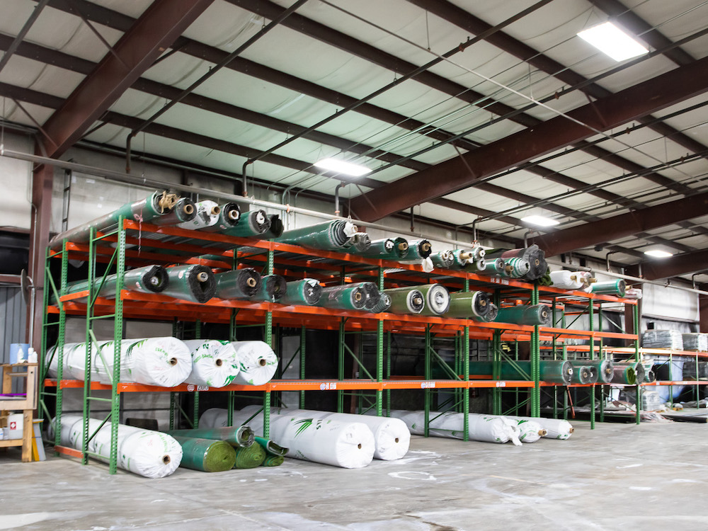 Rolls of artificial turf supply in the Goat Turf warehouse